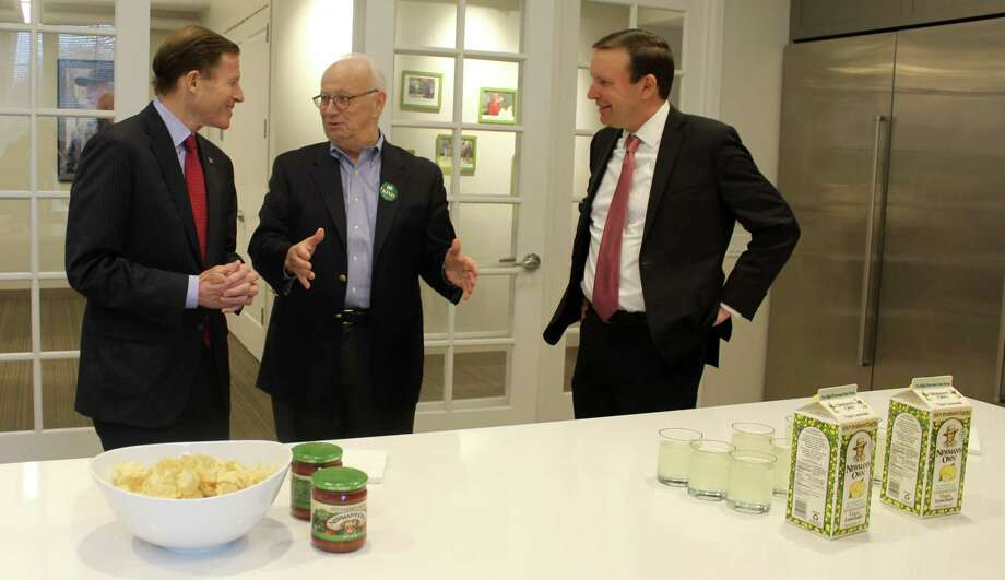U.S. Sen. Richard Blumenthal, Newman's Own Foundation President and CEO Bob Forrester, and U.S. Sen. Chris Murphy celebrate the passage of the Philanthropic Enterprise Act at Newman's Own headquarters in Westport Photo: Sophie Vaughan /Hearst Connecticut Media