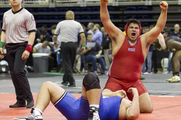 Joshua Tatman of Oak Ridge reacts after defeating George Marsh of New Braunfels in a Class 6A boys 285-pound bout during the UIL State Wrestling Championships at the Berry Center, Friday, Feb. 23, 2018, in Cypress.