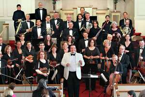 The American Chamber Orchestra, shown above with its Maestro Christopher Hisey (white jacket), will join forces with singers from the Connecticut Gilbert and Sullivan Society on Saturday, March 3, in Fairfield.