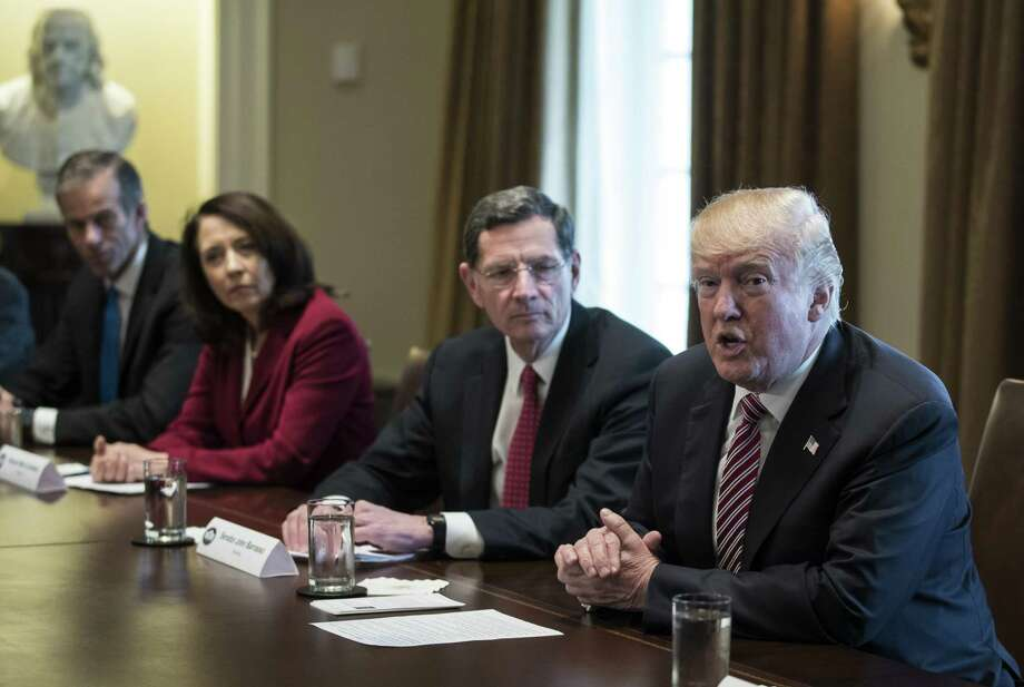 President Donald Trump, joined by from left, Sen. John Thune, R-S.D., Sen. Maria Cantwell, D-Wash., and Sen. John Barrasso, R-Wyo., speaks to media during a meeting with bipartisan Members of Congress about infrastructure in the White House Feb. 14. The plan should be dead on arrival. Photo: Carolyn Kaster /Associated Press / Copyright 2018 The Associated Press. All rights reserved.