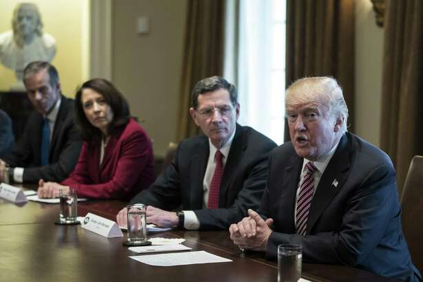 President Donald Trump, joined by from left, Sen. John Thune, R-S.D., Sen. Maria Cantwell, D-Wash., and Sen. John Barrasso, R-Wyo., speaks to media during a meeting with bipartisan Members of Congress about infrastructure in the White House Feb. 14. The plan should be dead on arrival.