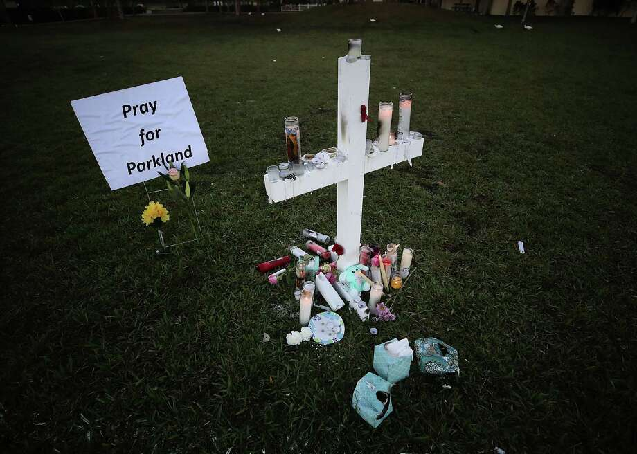 Candles glow after a late-night vigil for victims of the mass shooting at Marjory Stoneman Douglas High School in Parkland, Fla. In the wake of the murders, a reader notes a disturbing lack of urgency on gun control. Photo: Mark Wilson / Getty Images / 2018 Getty Images