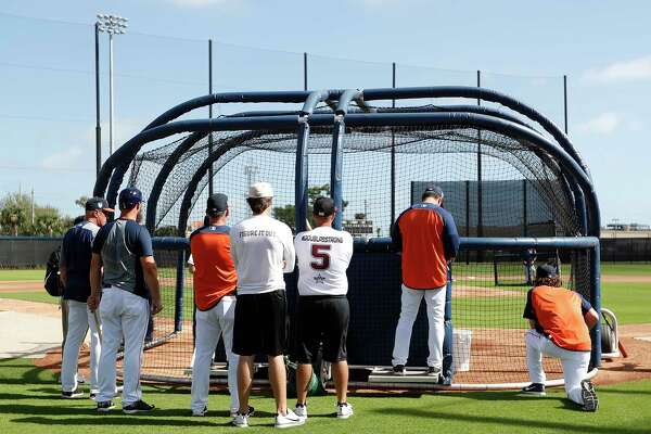 Douglas Stoneman High School's baseball head coach Todd  Fitz-Gerald, right, and his son, Hunter Fitz-Gerald, left, watch the Houston Astros batting practice during spring training at The Fitteam Ballpark of the Palm Beaches, Friday, Feb. 23, 2018, in West Palm Beach.   ( Karen Warren / Houston Chronicle )