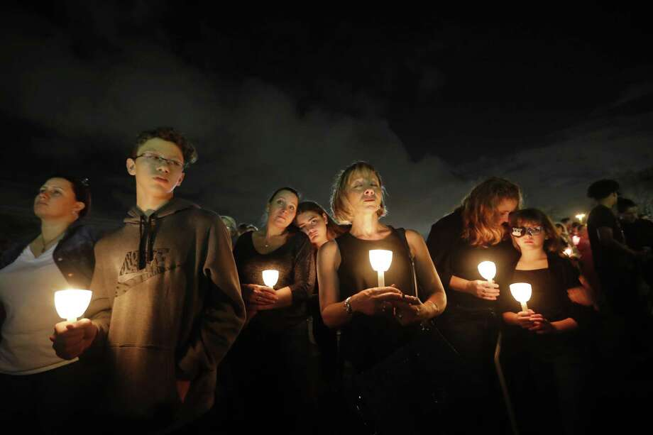 A candlelight vigil honors the 17 students and faculty killed in the mass shooting at Marjory Stoneman Douglas High School in Parkland, Fla. We all know this national nightmare won't end here. Photo: Gerald Herbert /Associated Press / Copyright 2018 The Associated Press. All rights reserved.