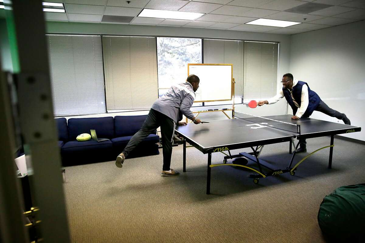 A lunchtime ping pong gameat Robert Dim, (left) and Kelechi Nwadibia the headquarters of HackerRank in Palo Alto, Calif., on Feb. 21, 2018.