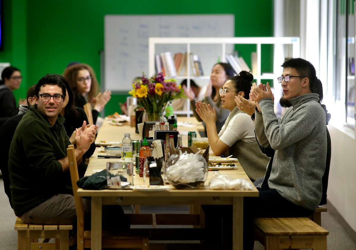 Employees applaud a promotion announcement during their lunch break at the headquarters of HackerRank in Palo Alto, Calif., on Feb. 21, 2018.