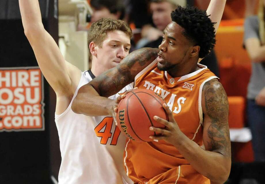 Texas center Prince Ibeh, right, looks for a path around Oklahoma State forward Mitchell Solomon, in the first half of an NCAA college basketball game in Stillwater, Okla., Friday, March. 4, 2016. (AP Photo/Brody Schmidt) Photo: BRODY SCHMIDT, FRE / AP / FR79308 AP