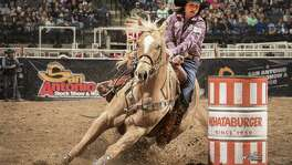 Hailey Kinsel set a new San Antonio Rodeo record on Wednesday night. She and her seven-year-old mare, DM Sissy Hayday, stopped the clock in 13.60 seconds in the AT&T Center.