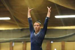 Foran's Brianna Laggis is happy to still be involved with gymnastics after her career was derailed by injuries including a back fracture.
