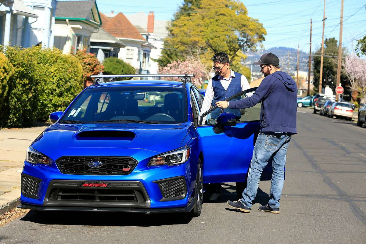 David Chu (l to r) and Tyler Karon, both of Alameda, talk as Karon picks up Chu's car which he rented through Turo in Alameda, Calif., on Friday, February 23, 2018.