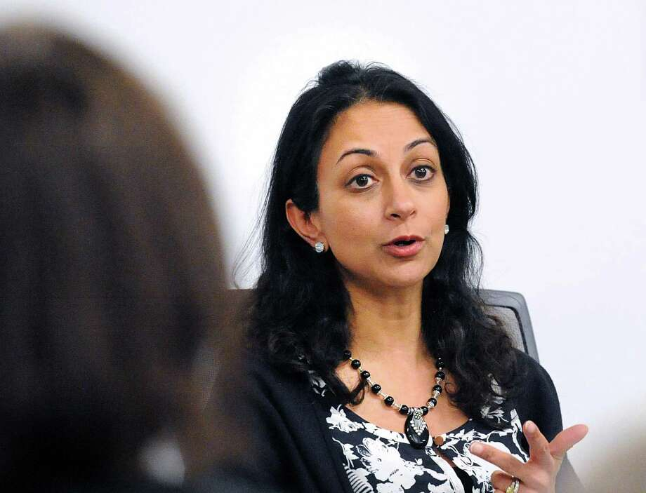 "Former Wall Street trader Dita Bhargava of Greenwich, a Democrat considering a run for governor, makes a point about pay equity for women during a panel discussion after the screening of the film ""Battle of the Sexes"" featuring the life story of tennis great Billie Jean King's 1973 matchup with Bobby Riggs at Fairfield County's Community Foundation in Norwalk, Conn., Thursday night, Feb. 15, 2018. Photo: Bob Luckey Jr. / Hearst Connecticut Media / Greenwich Time"