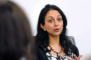"""Former Wall Street trader Dita Bhargava of Greenwich, a Democrat considering a run for governor, makes a point about pay equity for women during a panel discussion after the screening of the film """"Battle of the Sexes"""" featuring the life story of tennis great Billie Jean King's 1973 matchup with Bobby Riggs at Fairfield County's Community Foundation in Norwalk, Conn., Thursday night, Feb. 15, 2018."""