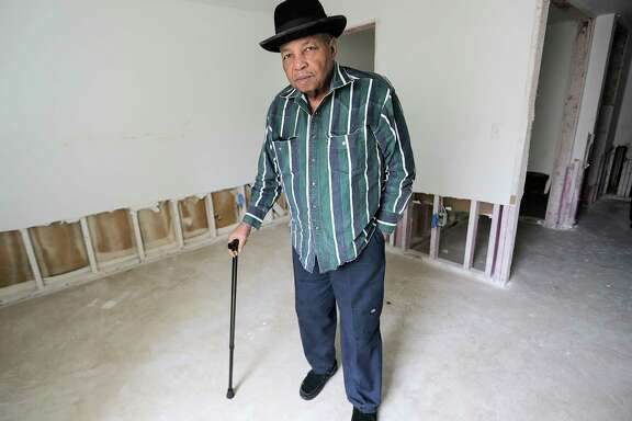 Raymond Chizer poses for a photo his apartment, at Arbor Court that was damaged from flooding resulting after Hurricane Harvey on Tuesday, Feb. 13, 2018, in Houston. ( Elizabeth Conley / Houston Chronicle )