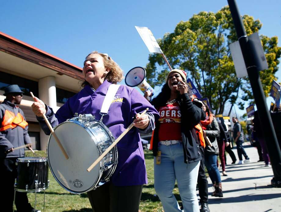 Marta Dominguez bangs on a drum as workers, concerned about job cuts and outsourcing, stage a rally at the Kaiser Permanente Medical Center in San Jose. Photo: Paul Chinn, The Chronicle