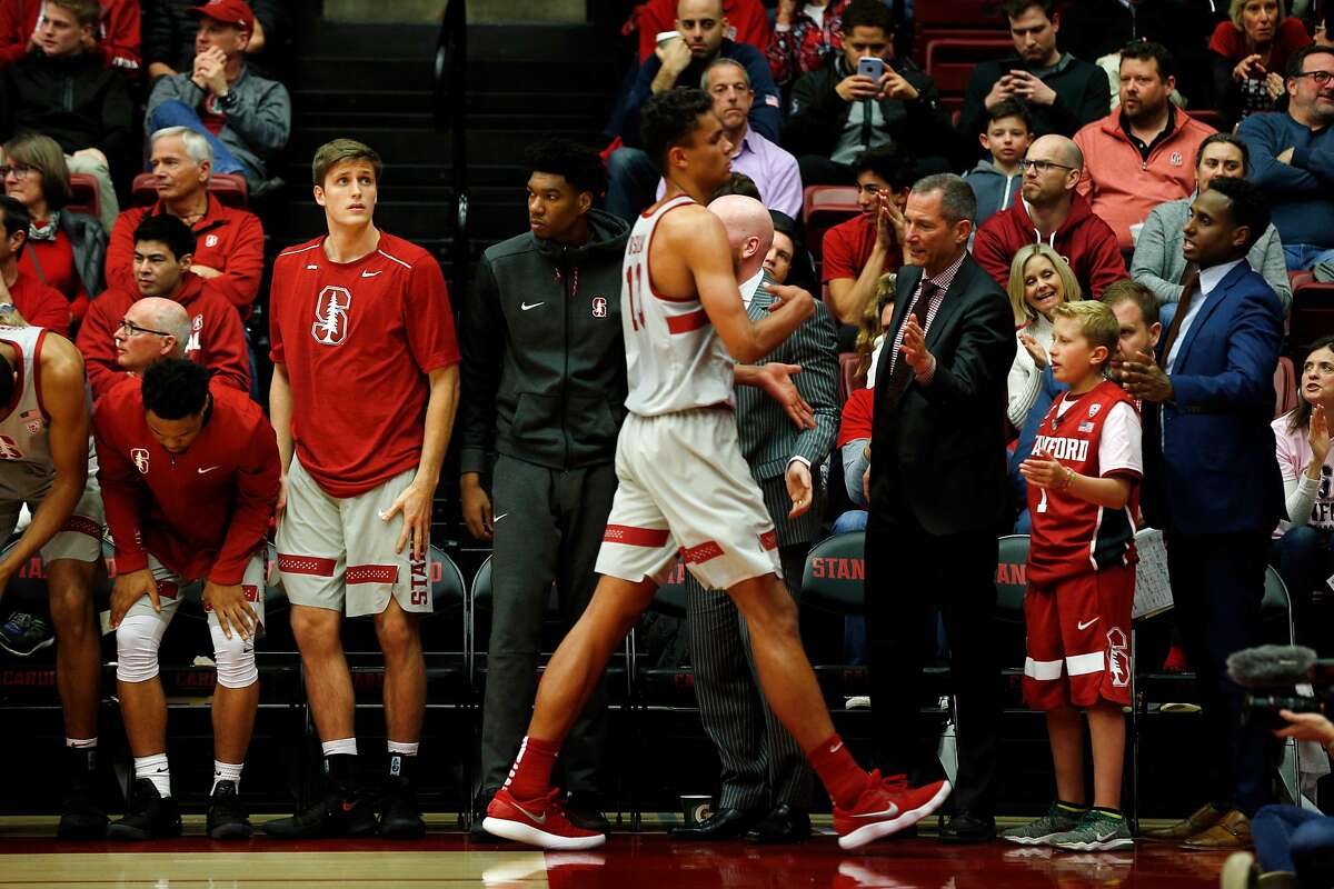 Second from right: Ty Whisler, 11, with the Stanford Cardinal bench greet Oscar Da Silva during the basketball game between the Stanford Cardinal and Washington Huskies at Maples Pavilion, Thursday, Feb. 22, 2018, in Stanford, Calif. The Cardinal won 94-78.
