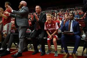 Second from right: Ty Whisler, 11, with the Stanford Cardinal bench cheer during the basketball game between the Stanford Cardinal and Washington Huskies at Maples Pavilion, Thursday, Feb. 22, 2018, in Stanford, Calif. The Cardinal won 94-78.