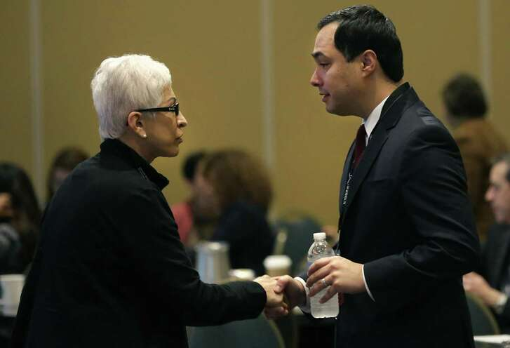 U.S. Rep. Joaquin Castro, right, speaks to Ysabel Duron of the Latino Cancer Institute in San Jose, California, at the Conference Advancing the Science of Cancer in Latinos at the Marriott Plaza on Friday, Feb. 23, 2018.