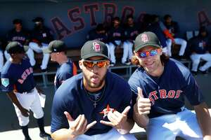 Houston Astros George Springer (4) and Josh Reddick (22) wearing Stoneman Douglas Eagles baseball caps in the dugout before the start of the Houston Astros spring training game against the Nationals at The Fitteam Ballpark of the Palm Beaches, Friday, Feb. 23, 2018, in West Palm Beach.