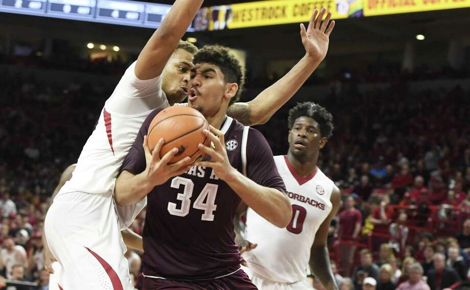 Texas A&M center Tyler Davis tries to drive past Arkansas defender Daniel Gafford during the second half of an NCAA college basketball game Saturday, Feb. 17, 2018, in Fayetteville, Ark. (AP Photo/Michael Woods) Photo: Michael Woods, FRE / Associated Press / Associated Press