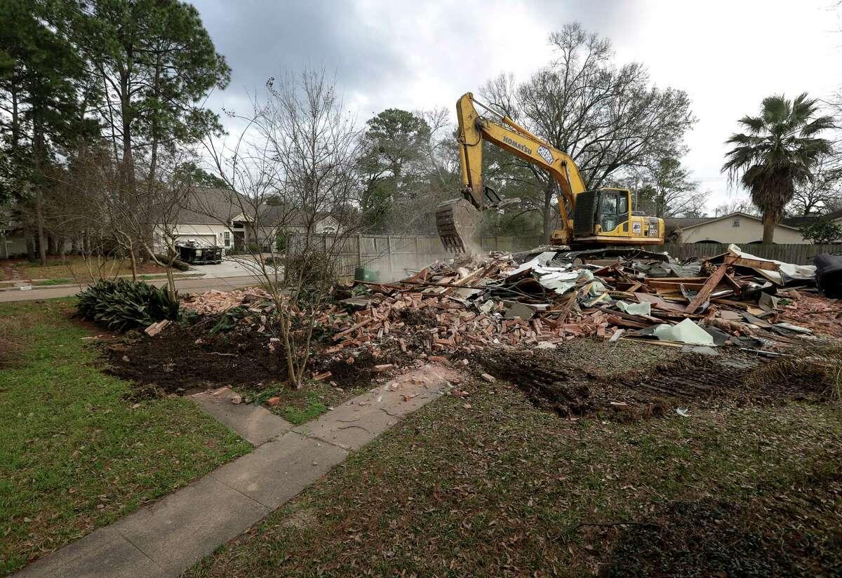 Sam Scott's mid-century modern style home on Figaro Drive, which flooded during Hurricane Harvey, is demolished, Friday, Feb. 16, 2018, in Houston. ( Jon Shapley / Houston Chronicle )