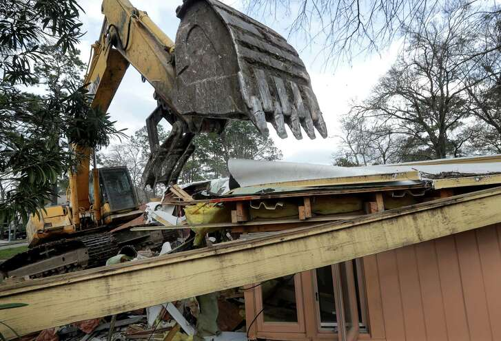 Sam Scott's mid-century modern style home on Figaro Drive, which flooded during Hurricane Harvey, is demolished, Friday, Feb. 16, 2018, in Houston.  ( Jon Shapley / Houston Chronicle )