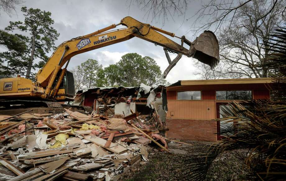 A home flooded during Hurricane Harvey is demolished, Feb. 16, 2018, in Houston. Texas insurance companies say they've had a spike in flood insurance policies after the storm's destruction. ( Jon Shapley / Houston Chronicle ) Photo: Jon Shapley, Houston Chronicle / © 2018 Houston Chronicle