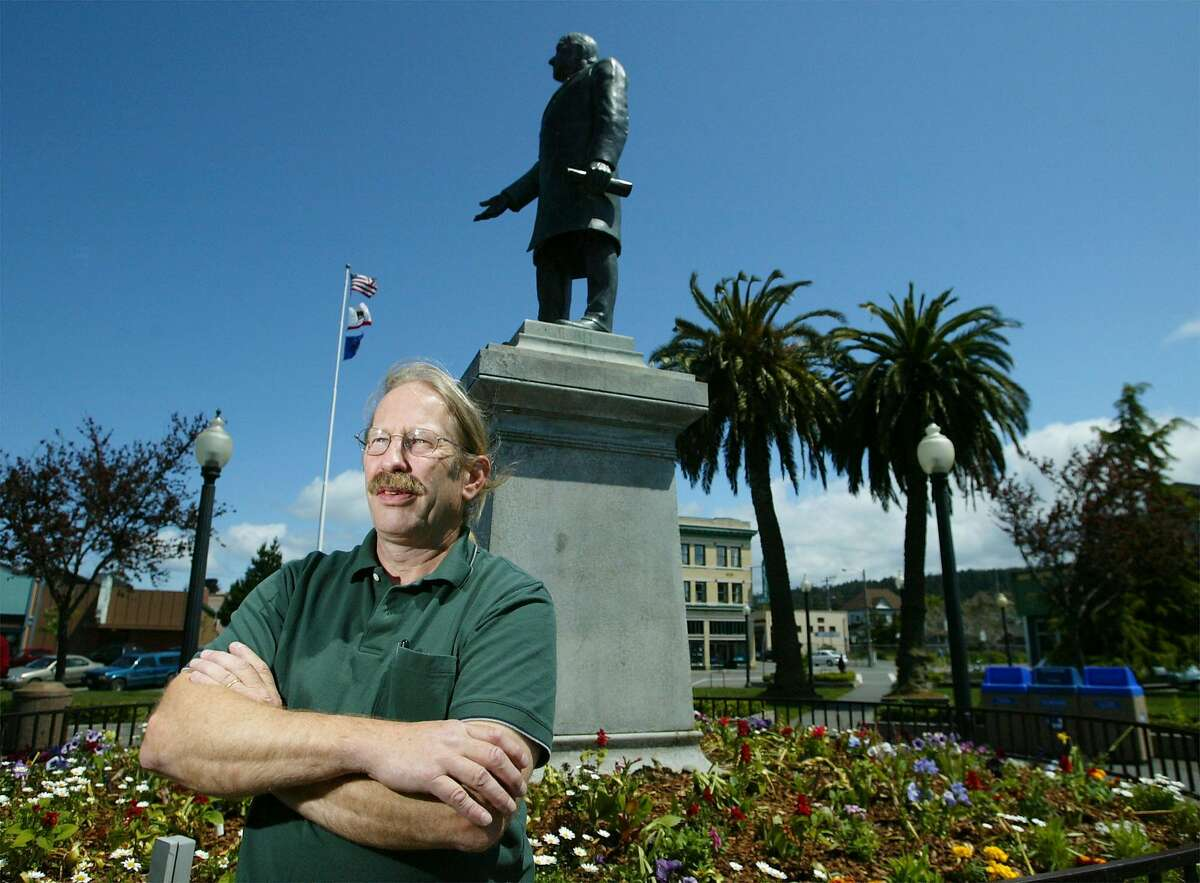 In this file photo, former Arcata councilman Dave Meserve stands beneath a statue of President McKinley in the center of the square in Arcata, Calif., Friday, May 9, 2003.