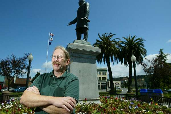 """** ADVANCE FOR WEEKEND MAY 17-18 ** Arcata councilman Dave Meserve stands beneath a statue of President McKinley in the center of the square in Arcata, Calif., Friday, May 9, 2003  More than 100 cities, and one state, have condemned the USA Patriot Act as giving the government too much snooping power. In Arcata, a liberal fold in Northern California's Redwood Curtain, the City Council has gone a step farther and criminalized it. Starting this month, a new city ordinance makes it a crime punishable by a$57 fine for a city department head to """"voluntarily"""" comply with the federal law.  (AP Photo/Eric Risberg)"""