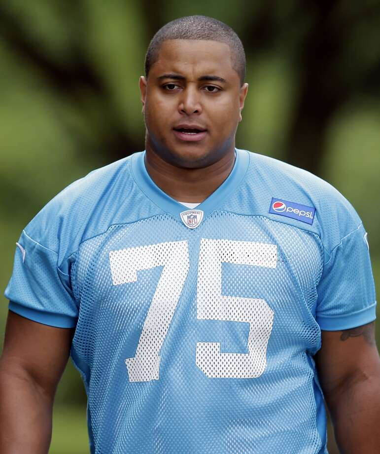 Former 49ers lineman Jonathan Martin was ordered to stand trial on three felony threatening charges after posting a photo on Instagram showing a shotgun and shotgun shells lying on a bed. Photo: Chuck Burton, Associated Press