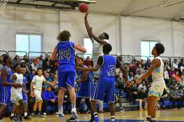 Brandon Gadsden (10) of the Kolbe Cathedral Cougars puts up a short jump shot during a game against the Bunnell Bulldogs at the Shehan Center on Friday February 23, 2018 in Bridgeport, Connecticut.
