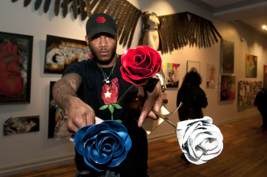 "Artist and sculptor Byron Troy holds a few of his welded steel roses during the opening reception for the CT Arts Against Violence art show at the Blends Gallery, in Bridgeport, Conn. Feb. 23, 2018. This year's show is, featuring a wide variety of art from local artists is titled ""Less Guns, More Roses"". Photo: Ned Gerard / Hearst Connecticut Media / Connecticut Post"