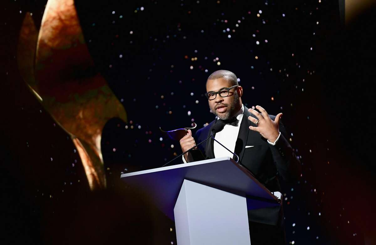 BEVERLY HILLS, CA - FEBRUARY 11: Writer-director Jordan Peele accepts the Original Screenplay award for 'Get Out' onstage during the 2018 Writers Guild Awards L.A. Ceremony at The Beverly Hilton Hotel on February 11, 2018 in Beverly Hills, California. (Photo by Emma McIntyre/Getty Images)
