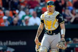 BALTIMORE, MD - AUGUST 23:  Bruce Maxwell #13 of the Oakland Athletics throws the ball to second base against the Baltimore Orioles at Oriole Park at Camden Yards on August 23, 2017 in Baltimore, Maryland.  (Photo by G Fiume/Getty Images)