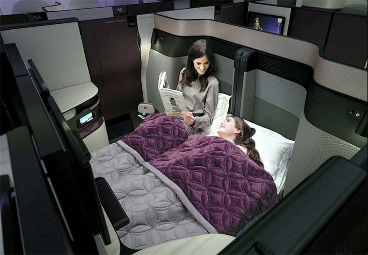 Qatar's new Qsuite business class seat permits creation of private double-bedded accommodations.