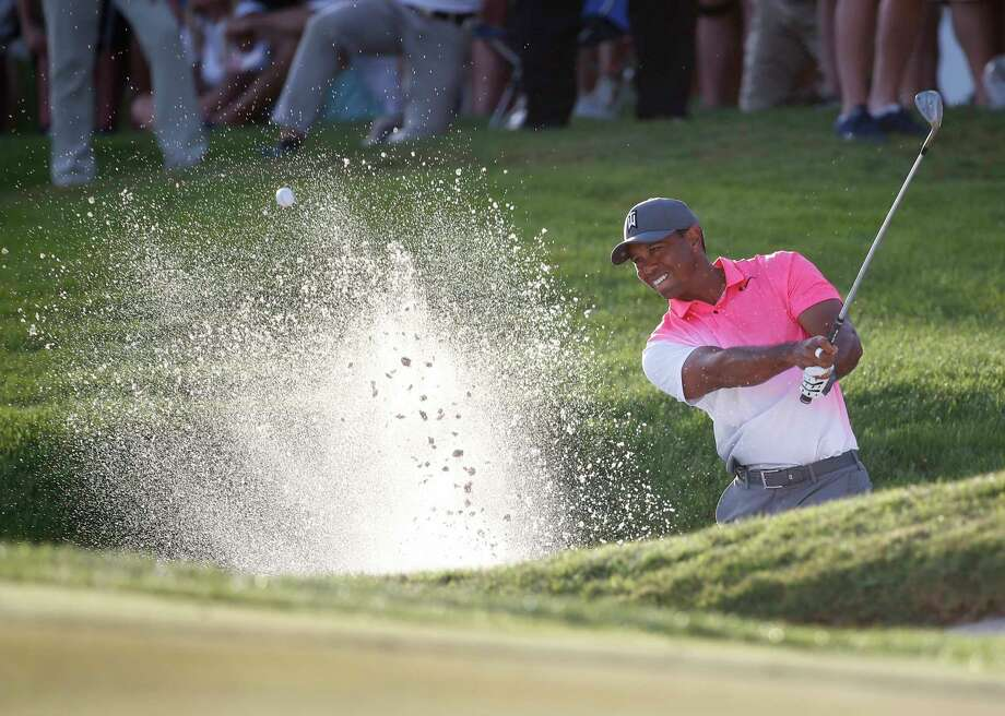 Tiger Woods hits out of a bunker on the 18th hole during the second round of the Honda Classic golf tournament, Friday, Feb. 23, 2018, in Palm Beach Gardens, Fla. (AP Photo/Wilfredo Lee) Photo: Wilfredo Lee, STF / Copyright 2018 The Associated Press. All rights reserved.