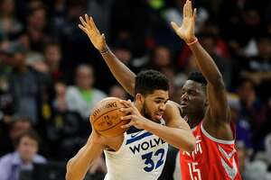 MINNEAPOLIS, MN - FEBRUARY 13: Clint Capela #15 of the Houston Rockets defends against Karl-Anthony Towns #32 of the Minnesota Timberwolves during the game on February 13, 2018 at the Target Center in Minneapolis, Minnesota. NOTE TO USER: User expressly acknowledges and agrees that, by downloading and or using this Photograph, user is consenting to the terms and conditions of the Getty Images License Agreement. (Photo by Hannah Foslien/Getty Images)