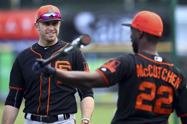 Two of the primary reasons for the Giants' early optimism: offseason acquisitions Evan Longoria, left, and Andrew McCutchen.