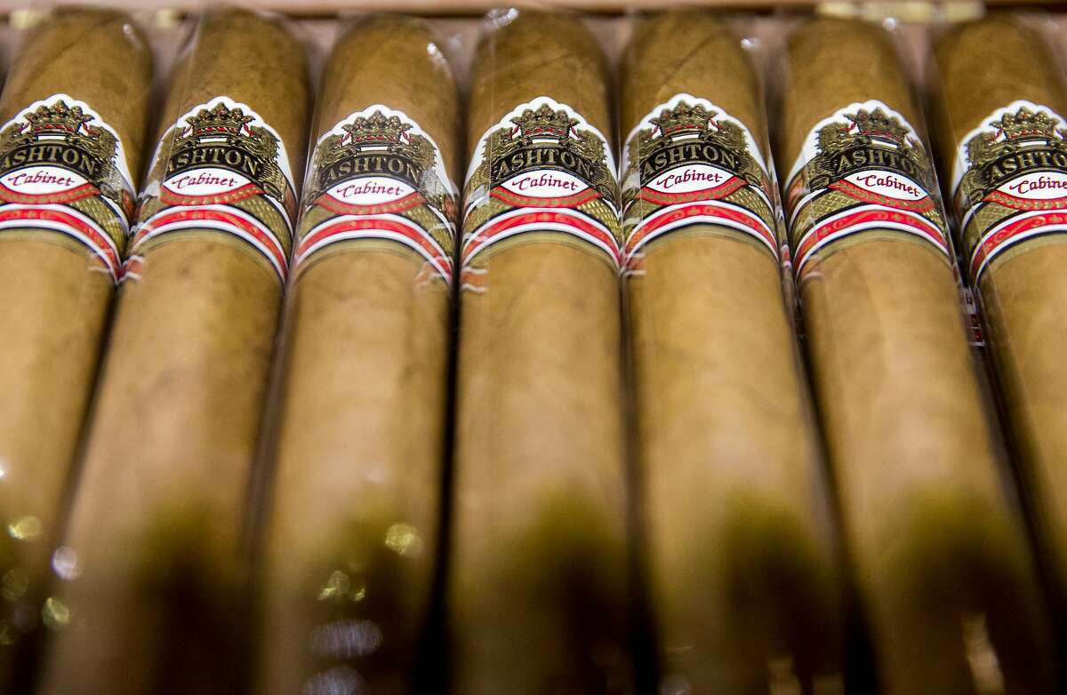 A row of cigars are seen for sale behind a locked case at Occidental Cigar Club Thursday, Feb. 22, 2018 in San Francisco, Calif.