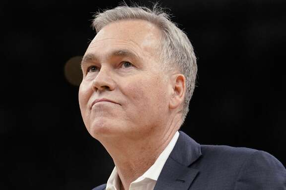 Houston Rockets coach Mike D'Antoni walks onto the court during a timeout in the second half of the team's NBA basketball game against the San Antonio Spurs, Thursday, Feb. 1, 2018, in San Antonio. Houston won 102-91. (AP Photo/Darren Abate)
