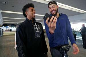 Golden State Warriors' JaVale McGee and Nick Young take part in a promotional event at the United Terminal at SFO in San Francisco, Calif., on Wednesday, January 24, 2018.