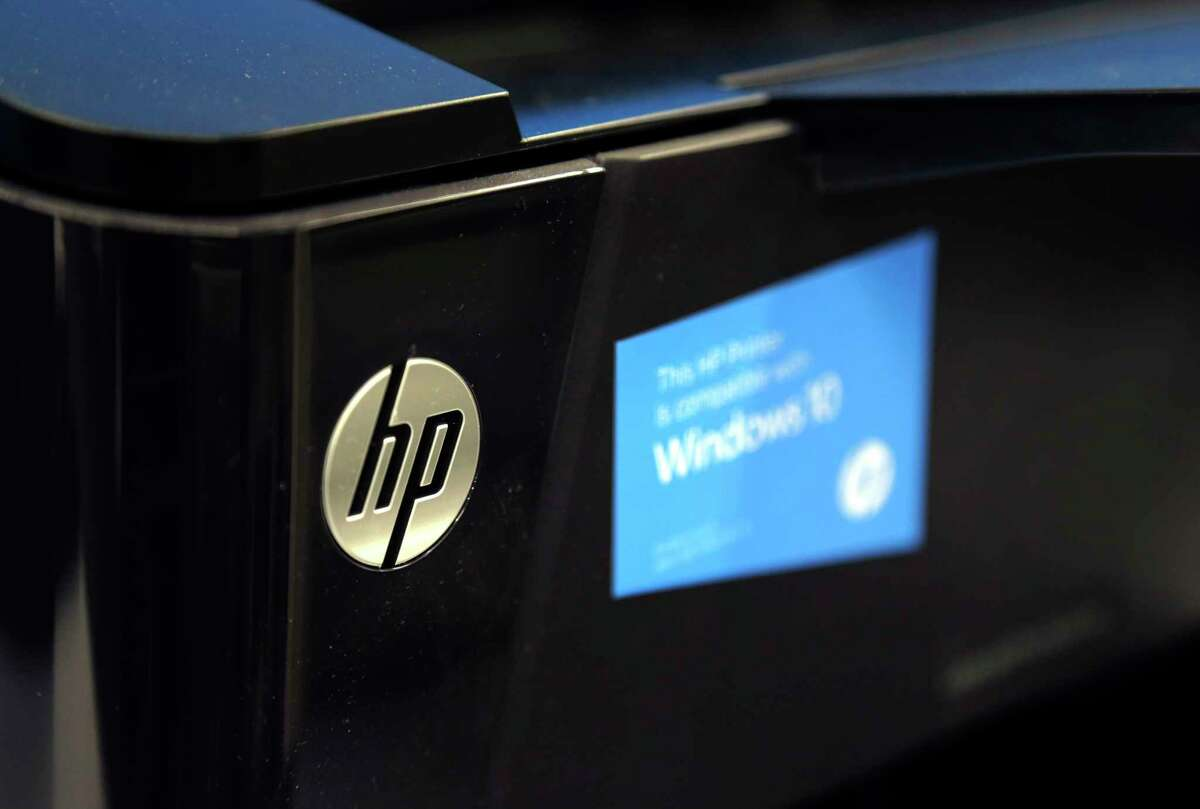 FILE - This May 24, 2016, file photo shows an HP printer on display at a store, in North Andover, Mass. HP Inc. reports financial results Thursday, Feb. 22, 2018. (AP Photo/Elise Amendola, File)