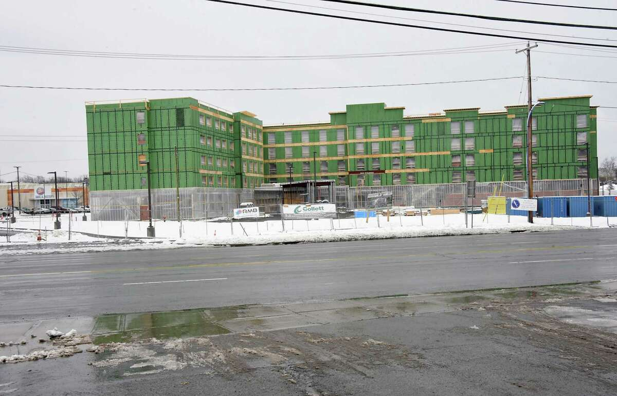 Construction continues on Homewood Suites by Hilton in front of Crossgates Mall on Friday, Feb. 23, 2018 in Guilderland, N.Y. The Mall is seen to the left of hotel. (Lori Van Buren/Times Union)