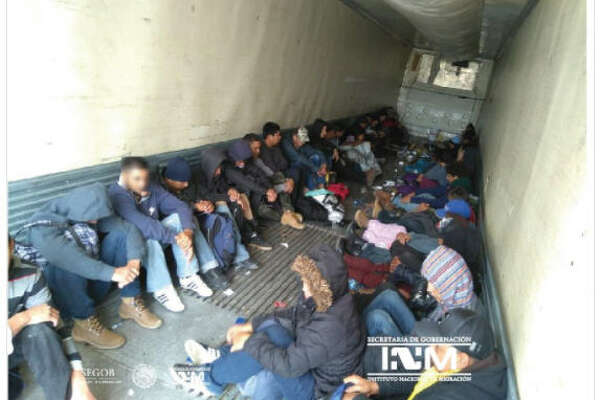Mexican immigration agents say they have found 103 Central American migrants in a freight trailer left by a roadside near the U.S. border.