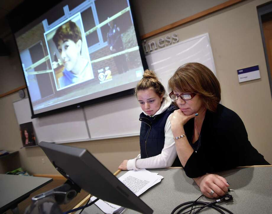 Alia Mostafa, left, president of the Collegiate Health Service Corps at the University of Bridgeport and a childhood friend of Maren Sanchez, and Sanchez's mother, Donna Cimarelli, watch a video segment reporting on Sanchez's death during a talk at the University of Bridgeport Friday. Photo: Arnold Gold / Hearst Connecticut Media / New Haven Register