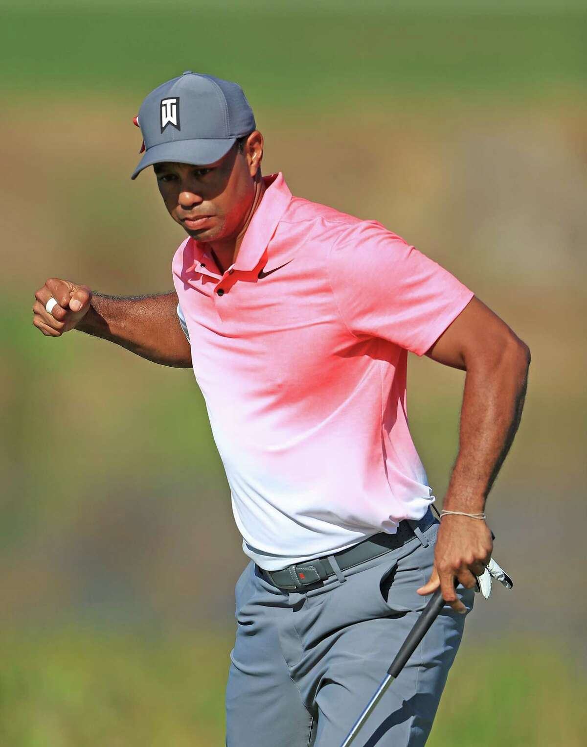 PALM BEACH GARDENS, FL - FEBRUARY 23: Tiger Woods reacts to birdie putt on the 11th hole during the second round of The Honda Classic at PGA National Resort and Spa on February 23, 2018 in Palm Beach Gardens, Florida. (Photo by Sam Greenwood/Getty Images)