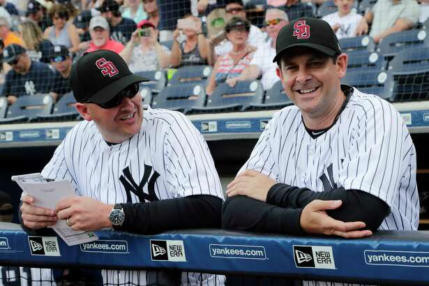New York Yankees manager Aaron Boone stands with bench coach Josh Bard, left, before a baseball spring exhibition game against the Detroit Tigers, Friday, Feb. 23, 2018, in Tampa, Fla. Boone is managing his first baseball game at any level. (AP Photo/Lynne Sladky)