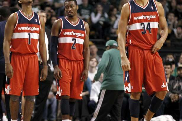 Nick Young (left), John Wall and JaVale McGee languished on an awful Wizards team in 2012. Young and McGee became close friends and mutual pranksters while in Washington and are up to their old tricks now that they're Warriors teammates.