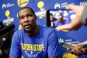 Kevin Durant talks with the media at the Warriors practice facility in Oakland, Calif., on Fri. Feb. 23, 2018.