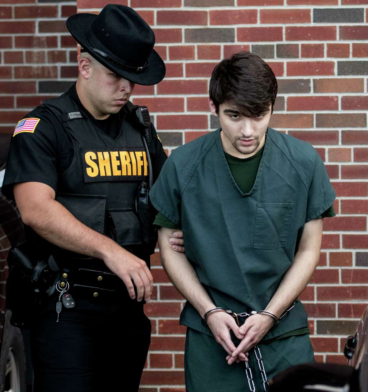 Nikolai Mavashev, 19, leaves Saratoga County Court Friday Sept. 21, 2017 in Ballston Spa, N.Y. after his arraignments on 29 charges the most serious of which is 1st degree murder related to the alleged shooting of a man inside his Mechanicville home in July. (Skip Dickstein/Times Union)