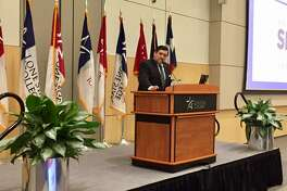 Lone Star College System Small Business Development Center Executive Director Miguel Lopez introduces Brady to the town hall meeting.
